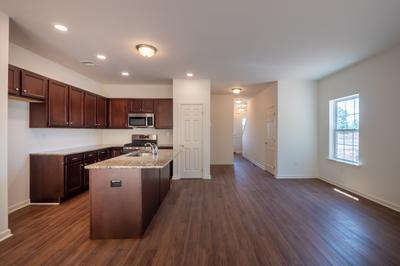 Towns at Woods Edge - Kitchen & Great Room. Towns at Woods Edge New Home in Drums, PA